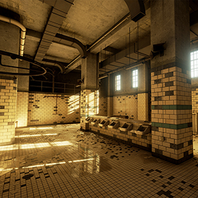 A wet, grungy bathroom located in an old maximum security prison.