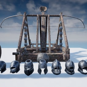 Catapult and a set of helmets from the middle ages