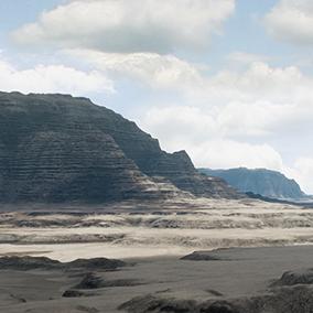 A huge sunny cloudy desert landscape.